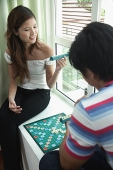 Couple at home playing scrabble - Asia Images Group