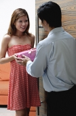 Man giving woman a present - Asia Images Group