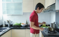 Man cooking in kitchen - Asia Images Group