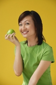 Young Woman holding apple - Asia Images Group