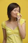 Young woman smelling lemon - Asia Images Group