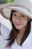 Young woman wearing hat - Asia Images Group
