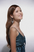 Woman smiling, looking away - Asia Images Group
