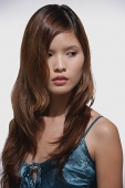 Woman with long hair, head shot - Asia Images Group