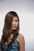 Woman with long hair, looking at camera, head shot - Asia Images Group
