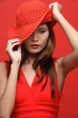 Woman in red dress with red hat - Asia Images Group