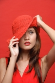 Woman in red dress with red hat, head shot - Asia Images Group