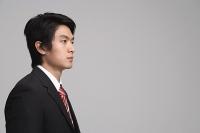 Businessman looking away, studio shot - Asia Images Group