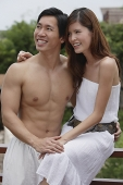 Couple smiling, looking away - Asia Images Group