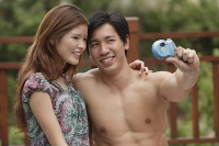 Couple posing for a picture - Asia Images Group