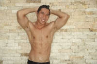 Shirtless man with hands on head - Asia Images Group
