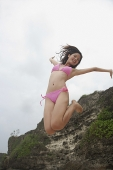 Woman jumping in air - Asia Images Group