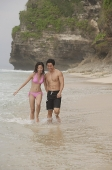 Couple walking on beach - Asia Images Group