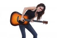 Young woman playing guitar, studio shot - Asia Images Group