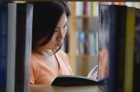Young woman in library - Asia Images Group