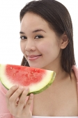 Young woman with slice of watermelon - Asia Images Group