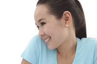 Young woman smiling, looking away, side view - Asia Images Group