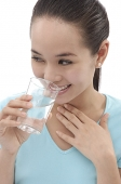 Young woman holding a glass of water - Asia Images Group