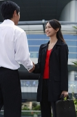 Executives shaking hands - Asia Images Group