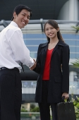 Executives shaking hands, smiling at camera - Asia Images Group