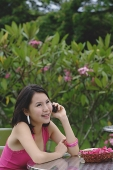 Young woman the phone, smiling - Asia Images Group