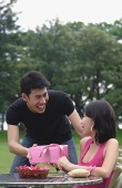 Man giving woman a gift - Asia Images Group