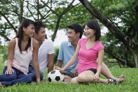 Young adults sitting in park - Asia Images Group