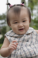Baby girl smiling at camera - Asia Images Group