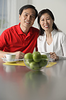 Mature couple at home, looking at camera, portrait - Asia Images Group