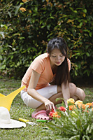 Woman gardening outdoors - Asia Images Group
