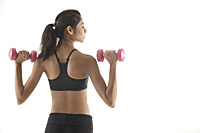 Woman with back to camera, lifting weights, working out - Asia Images Group