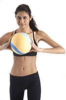 Woman holding volleyball, looking at camera - Asia Images Group
