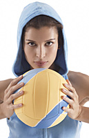 woman holding volleyball, looking at camera, intense - Asia Images Group