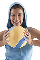 woman holding volleyball, smiling, looking at camera - Asia Images Group
