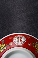 Close-up of bowl with the text -Double Happiness - Asia Images Group