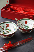 Chinese bowl, saucer and spoon set with the text -Double Happiness, paraphernalia of traditional Chinese Wedding - Asia Images Group