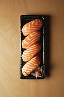 Four pieces of Salmon Sushi, nigiri on rice ball - Asia Images Group