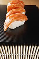 4 pieces of salmon sushi, nigiri - Asia Images Group