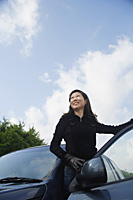 Mature woman getting out of car - Asia Images Group