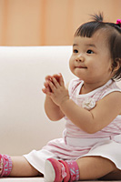 Baby Girl sitting and holding hands in prayer - Asia Images Group