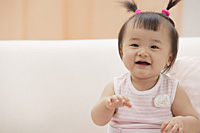 Baby girl laughing and smiling at camera - Asia Images Group