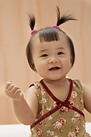 baby girl looking at camera, smiling - Asia Images Group