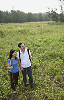 Man and woman hiking in nature, outdoors - Asia Images Group