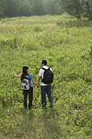 A couple hiking outdoors in the nature - Asia Images Group