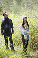 Man and woman walking through nature, outdoors, hiking - Asia Images Group
