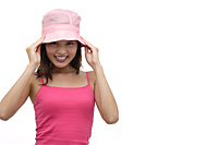 Young woman wearing pink hat and smiling at camera - Asia Images Group