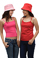 two young women wearing red and pink, looking at each other - Asia Images Group