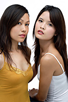 Two young women looking at camera, beauty - Asia Images Group