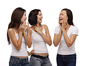 Three young women standing together and laughing - Asia Images Group