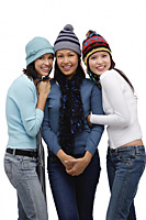 Three young women wearing scarves and hats, winter - Asia Images Group